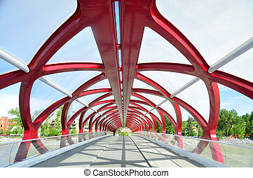 Calgary's Peace Bridge which spans the Bow River between ...
