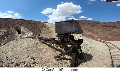 Heritage railroad in historic ghost town. Old steam train tour through old silver mines in Calico abandoned town. Calico Mountains of Mojave Desert region of Southern California, Unites States.