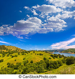 California meadows hill and lake in a blue sky spring day...