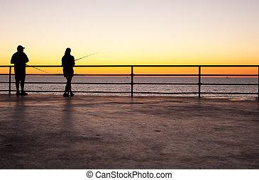 Pier fishing at sunset