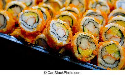 California roll maki sushi on a glass plate.