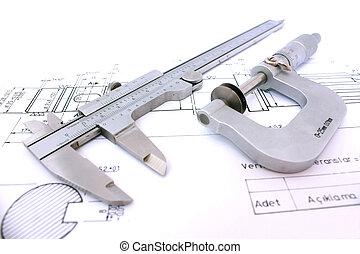 Caliper and Micrometer on blueprint horizontal close up....