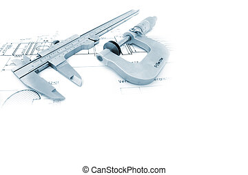Caliper and Micrometer on blueprint with copyspace
