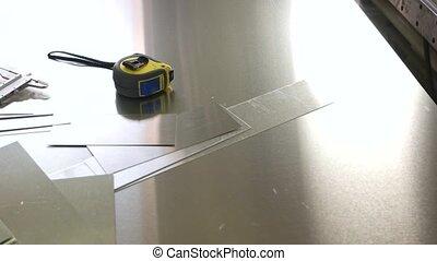 Caliper and tape measure. Measuring tools on metal...