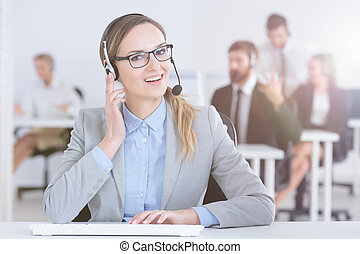 Call center agent at her desk