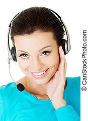 Call center assistant smiling - Friendly call center...