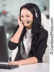 Call center - Attractive young woman is working in a call ...