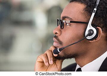 Call center - Close-up, side view of confident businessman...