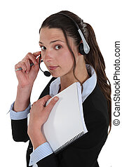 call center employee holding a notepad