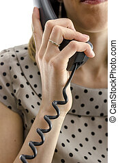 Call center employee holding a telephone