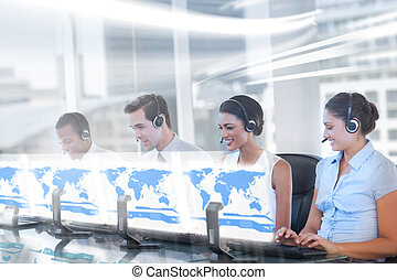 Call center employees at work on futuristic holograms in...