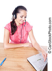 call center female operator. young happy smiling woman sitting at office desk with headset isolated on white background.