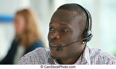 Call center operator providing the client with all the...