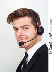 Call Center Representative Wearing Headset In Office