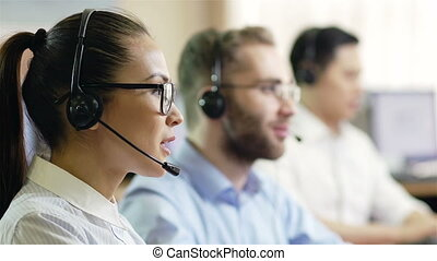 Call-center routine - Hot-line operators with headphones ...