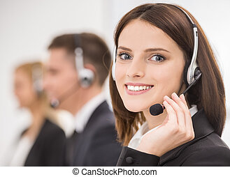 Call center - Smiling beautiful lady working at call center...
