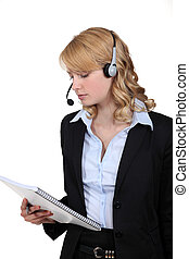 Call-center worker with note pad