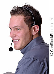 Call Center - Young Man Talking To A Client On The Telephone...