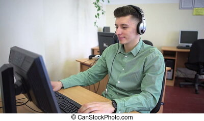Call centre agents working their bright office