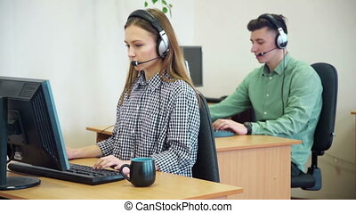Call centre agents working in their bright office - Call...