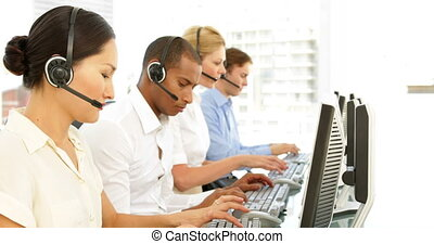 Call centre employees at work at the office