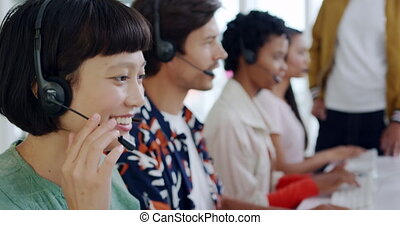 Call centre staff working in a modern office