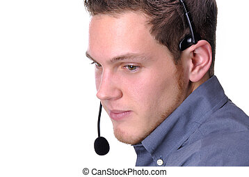 Call Centre - Young Man Wearing A Phone Headset In A Call...