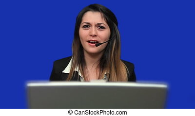 Call centre worker using laptop - Female call centre worker...