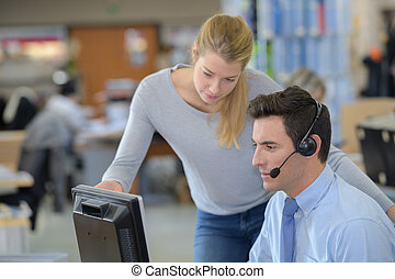call centre workers looking at computer screen