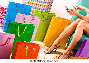Call during shopping - Image of woman dialling while...