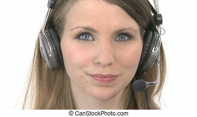 Callcenter Agent smiles - Callcenter Agent removes her...