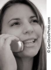 Caller 3 - A young woman on a cell phone. Soft focus in ...