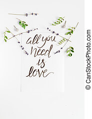 calligraphy floral pattern top view all you need is love