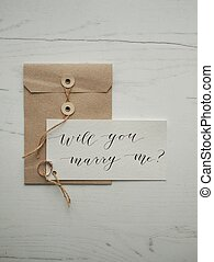 calligraphy letter will you marry me ring