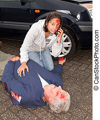 Injured woman calling for an ambulance after a car accident