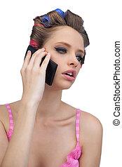 Calling model posing wearing hair rollers