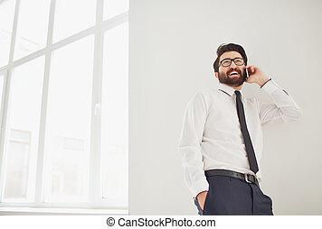 Calling - Portrait of elegant businessman speaking on ...
