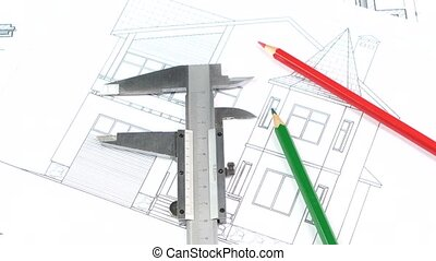 Calliper and pencils on the building plan, scheme, rotation...