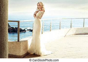 Calm blond bride waiting for her husband