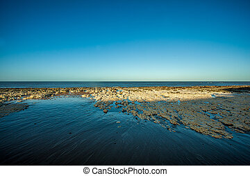 Calm blue ocean and sky