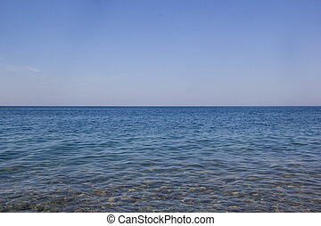 Calm Blue sea waves soft surface Ocean And Blue Sky Background