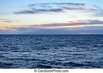 Calm Blue Waters With A Beautiful Orange Sky At Sunset On Las Americas Beach. April 11, 2019. Santa Cruz De Tenerife Spain Africa. Travel Tourism Street Photography.