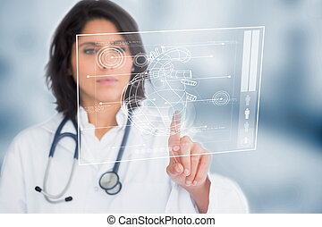 Calm doctor touching a medical interface