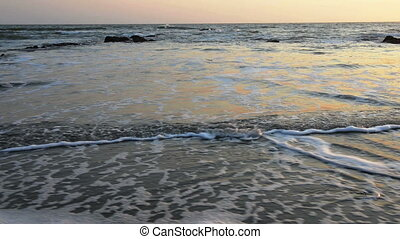 Calm evening surf at Atlantic Ocean coastline