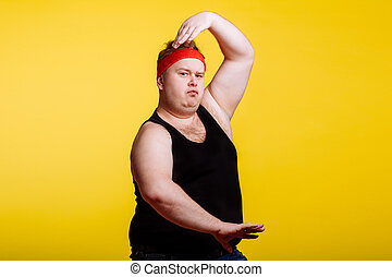 fat man makes kung-fu exercise, rise hands, crane pose