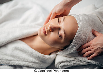 girl having spa facial massage in luxurious beauty salon