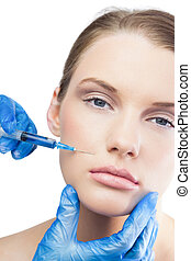 Calm gorgeous model having botox injection above the lips