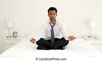 Calm handsome businessman meditatin