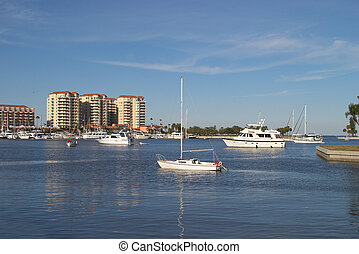 Calm Harbor - several boats at anchor in a calm harbor, with...