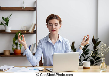 Calm healthy business woman meditate relaxing at office desk